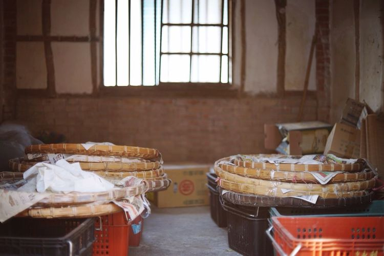 Crates and wicker baskets in workshop