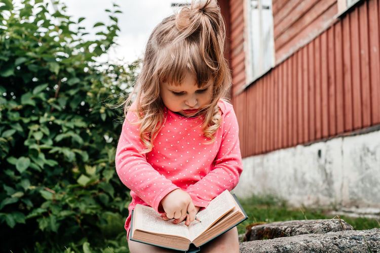 Portrait of a girl holding book