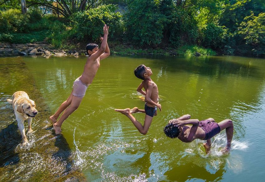 I had seen some kids playing with their dog at a small overflowing dam... when I approached them they saw my camera and asked me to take their photo as they jumped... pure luck how they just jumped fractions of a second after each other. Everyday Joy Eye4photography  India Streetphotography Having Fun Candid The Human Condition The Action Photographer - 2015 EyeEm Awards The Moment - 2015 EyeEm Awards Adventure Club