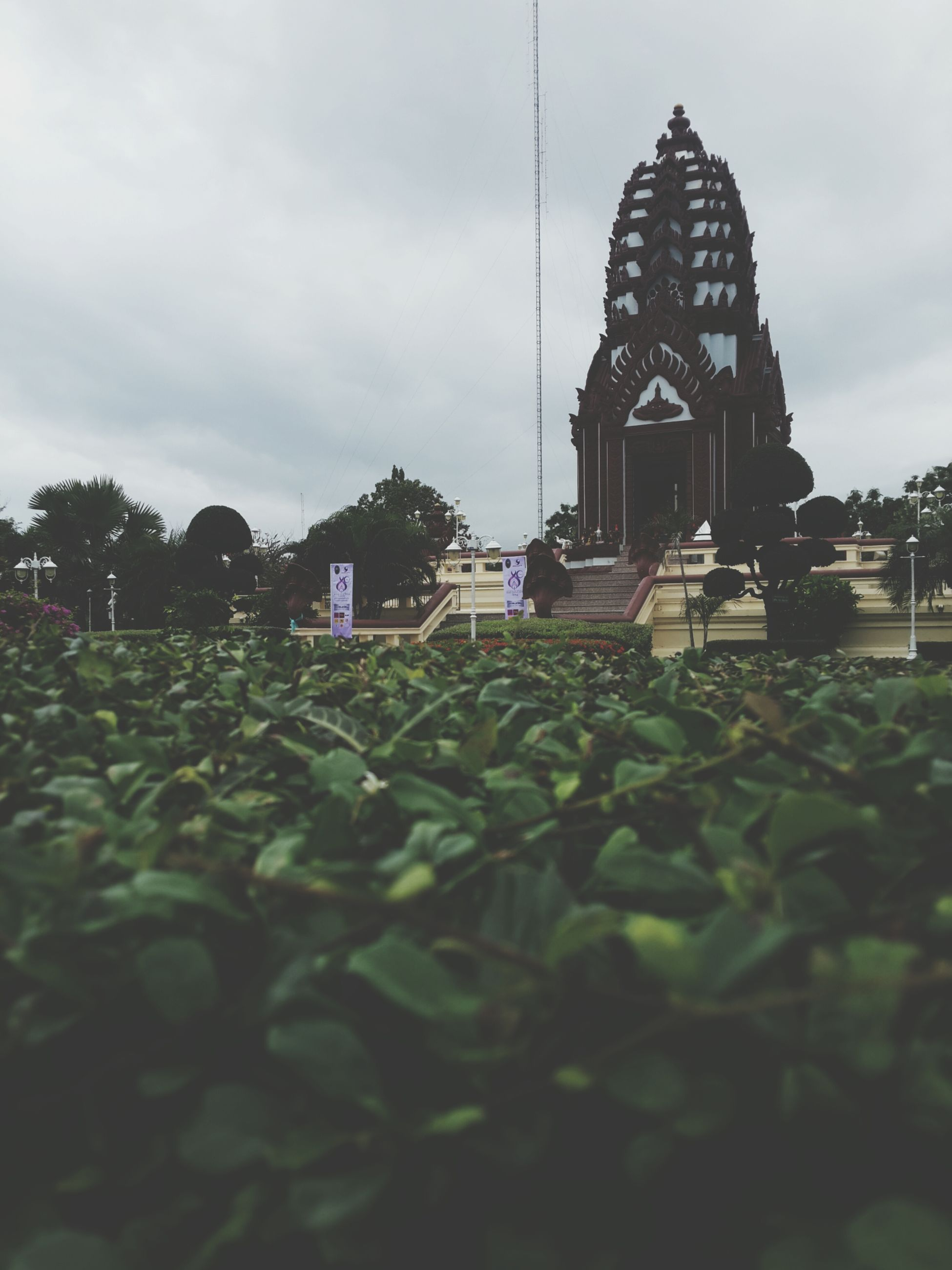 religion, building exterior, sky, spirituality, built structure, place of worship, architecture, plant, church, growth, cloud - sky, temple - building, tree, green color, outdoors, day, cloud