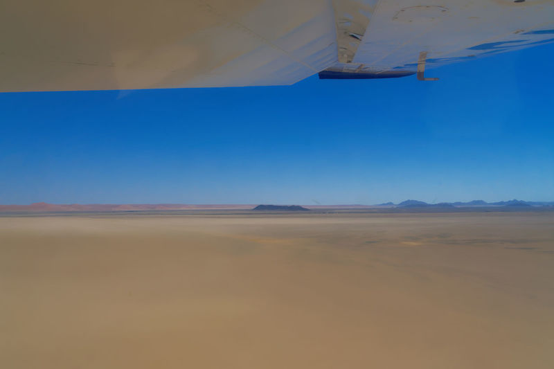 Touch down on Geluk Airstrip 24,40.6 S 015,47,3 E Nikon D500 Airplane Arid Climate Beauty In Nature Blue Day Desert Landscape Nature No People Outdoors Remote Sand Dune Scenics Sky Tranquil Scene Tranquility Transportation