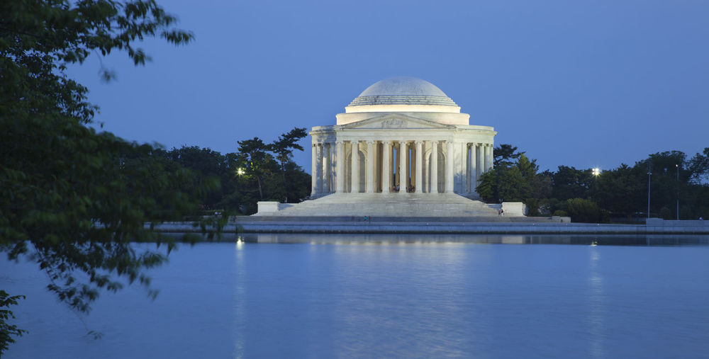 Thomas Jefferson Memorial By Tidal Basin Against Clear Sky At Dusk