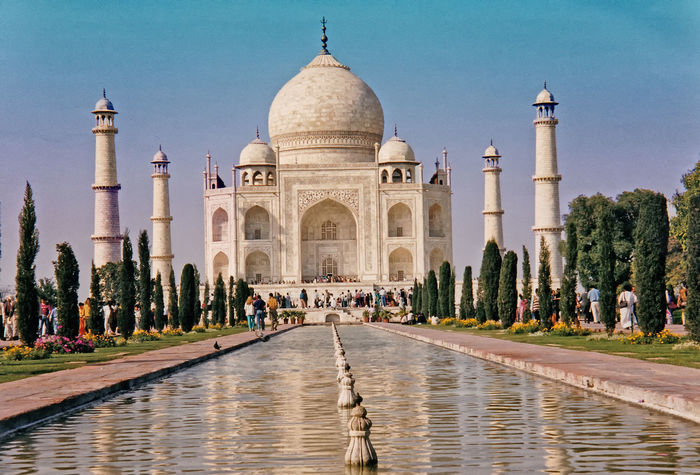 The Taj Mahal Indian Culture And History Architecture Reflection People Water Nature Real People Sky Tree Travel Tourism Day History Outdoors Vacations Dome Arch Reflecting Pool Travel Destinations Taj Mahal, Agra Large Group Of People Building Exterior Built Structure Romantic Monument