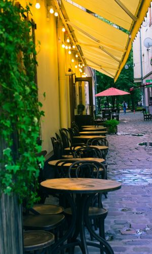 Ivano-Frankivsk, Ukraine Street Eating Outside Eating Ukraine Ivano-frankivsk Lightning Relaxing Time Relaxing Moments Outdoor Van Gogh Vincent Van Gogh Impressionism Evening Light Calm Vintage Style Vintage Table And Chairs Romantic Street Cafe Architecture Chair Gold Colored Table Illuminated Street Photography