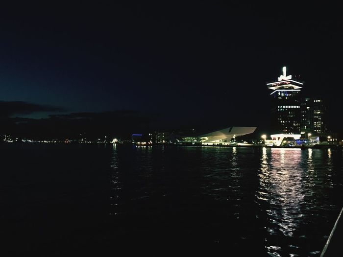 Night Illuminated Water No People Built Structure Sky Waterfront Architecture Outdoors Sea Building Exterior Nautical Vessel Nature Amsterdamcity Amsterdam Amsterdam Lookout Amsterdam Centraal Ferry By Boat Boat My City Home On My Way Home HUAWEI Photo Award: After Dark