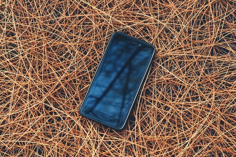 Close-Up Of Smart Phone On Twigs