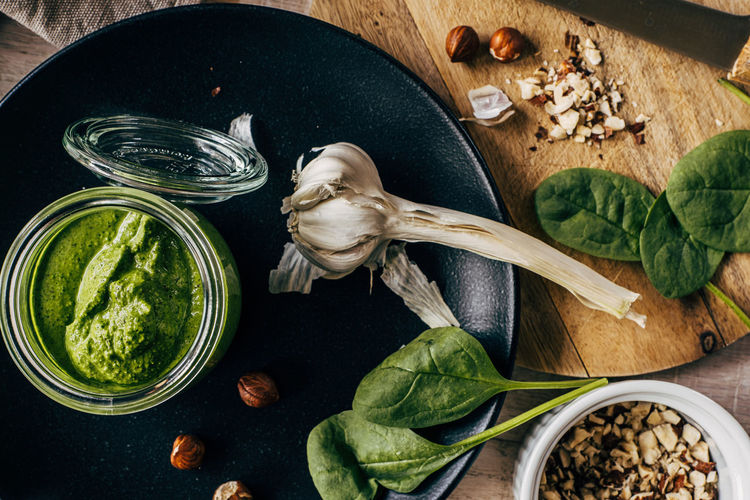 High angle view of food on table with garlic and spinach