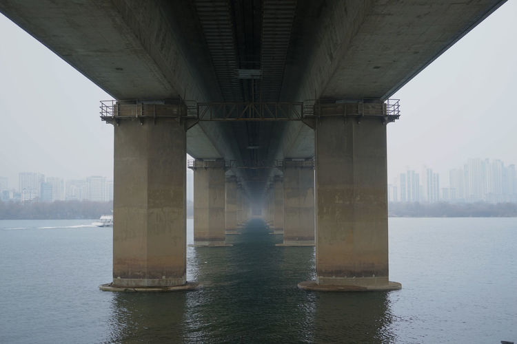 Air Pollution Cityscape Han River Architectural Column Architecture Below Bridge Bridge - Man Made Structure Built Structure City Connection Day Gloomy Day Gray Nature No People Outdoors River Sky Smog Transportation Underneath Water Waterfront