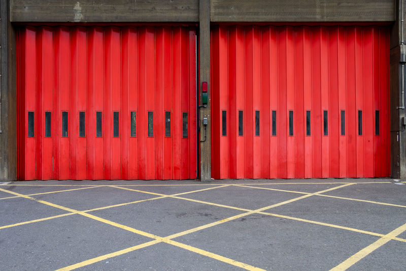 Grid Architecture Building Building Exterior Built Structure City Closed Day Door Entrance Fire Station Iron Metal Multi Colored No People Orange Color Outdoors Pattern Protection Red Safety Security Transportation Yellow