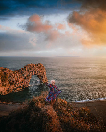 Sea Sky Water Horizon Over Water Cloud - Sky Horizon Beauty In Nature Scenics - Nature Rock Tranquility Nature Outdoors Leisure Activity United Kingdom Sunset Sunset_collection Ocean Photography Dress Canon Nature View Girl Photooftheday Travel Destinations