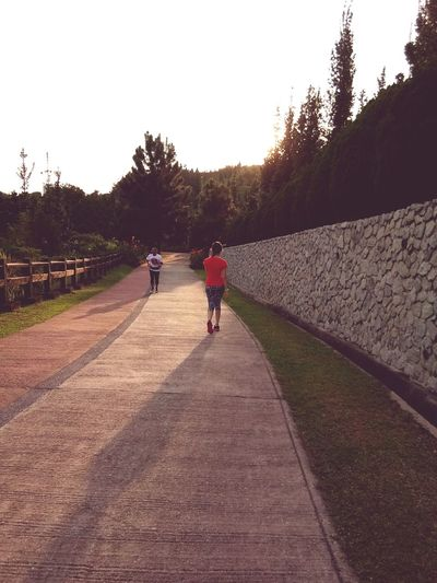 Outdoor activity Walking Full Length The Way Forward Tree Nature Outdoors Two People People Beauty In Nature Growth Day Adult Lush - Description Sky Adults Only Outdoor Jogging Track In Love To My Wife Malaysia Taman Saujana Hijau Putrajaya, Malaysia Brighten Day Sunset Summer Landscape