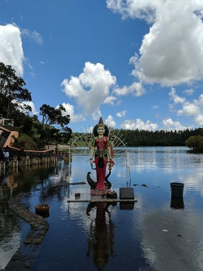 The Indian Goddess at Ganga Talao Lake in Mauritius. God Indian Travel Mauritius Day Goddess Idol Diety River India Tradition Cloud - Sky Water Outdoors River Sky People Nature Floating On Water First Eyeem Photo