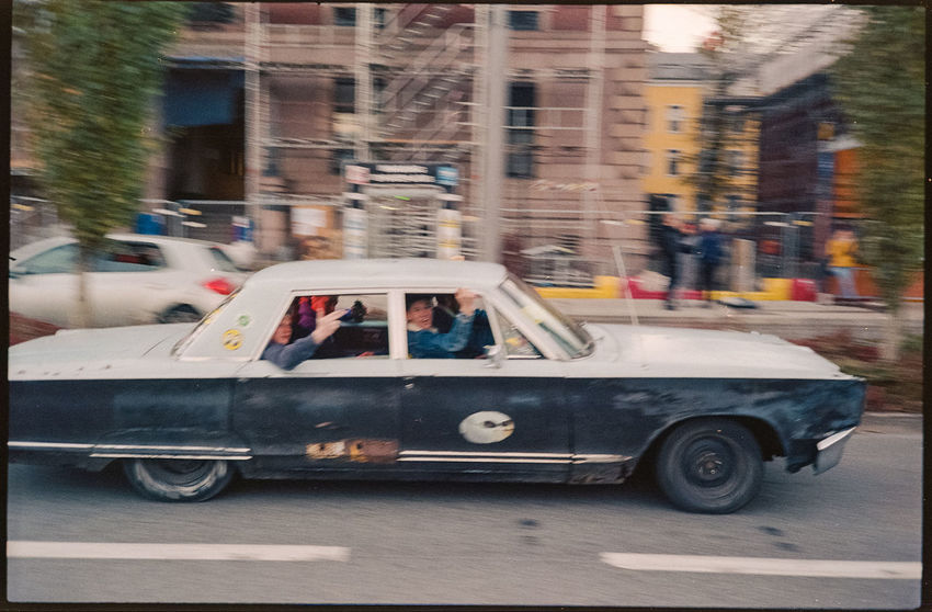 Youths in an old car. Shot with Rollei35S and Kodakcolor plus 200 Analogue Photography Analog 35mm Film Ishootfilm Colornegative Street Real People Incidental People City Life Blurred Motion Streetphotography Car Street Color Photography Filmisnotdead