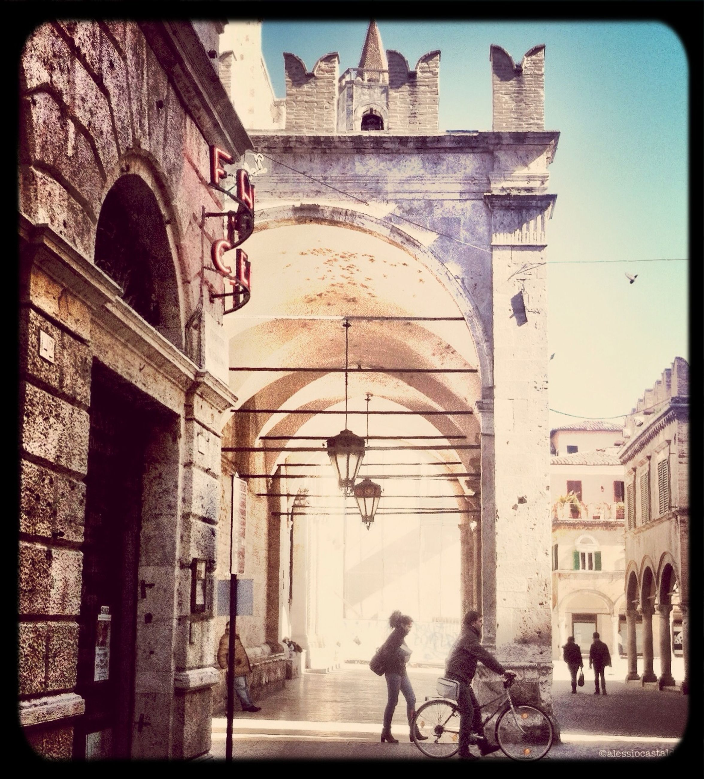 architecture, built structure, transfer print, building exterior, arch, men, auto post production filter, walking, person, lifestyles, leisure activity, large group of people, history, building, tourist, full length, city, old, old town