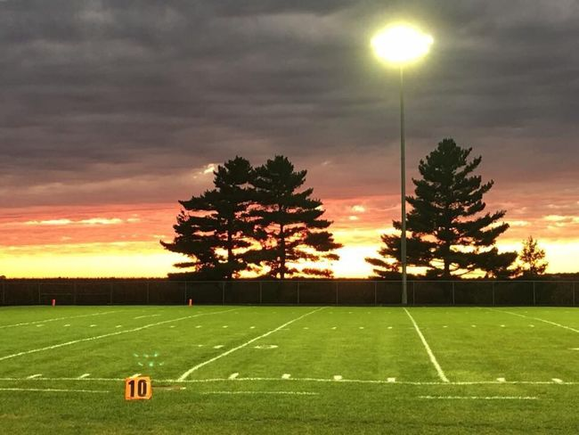 Tree Sunset Tranquil Scene Tranquility Landscape Sun Sky Scenics Orange Color Beauty In Nature Cloud - Sky Outdoors Sunbeam Solitude Nature Non-urban Scene Remote Dramatic Sky Lens Flare Green Color High School Football Game Friday Night Lights Fall Time 2016 EyeEm Best Shots