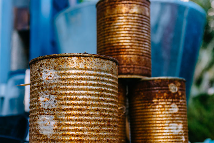 Close-up of rusty containers stack