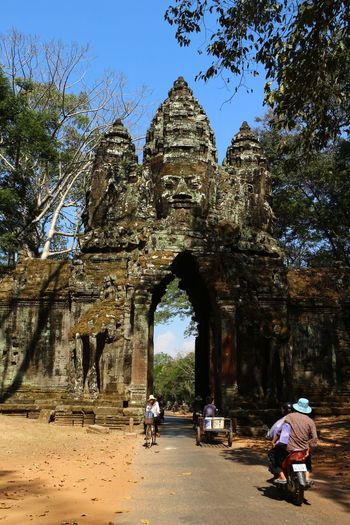 This is the North Gate of Angkor Thom and it's is still used today by locals and tourists alike. Angkor Thom Cambodia Sculpture Architectural Detail On The Road Passage EyeEm Nature Lover Eye4photography  Travel Photography Landscape_Collection Historical Building Street Photography Daily Life Daily Commute Commuting Gate Nature On Your Doorstep EyeEm Gallery Ancient Civilization Iconic Landmark