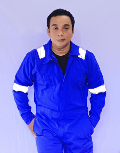 Portrait Asian Engineer Portrait Looking At Camera Studio Shot Winter Cold Temperature Blue Confidence  Standing Front View Attitude Masculinity Hands In Pockets Posing