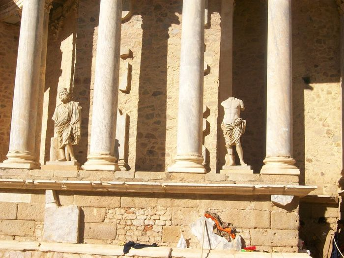 Low angle view of statues and columns at roman theatre in merida