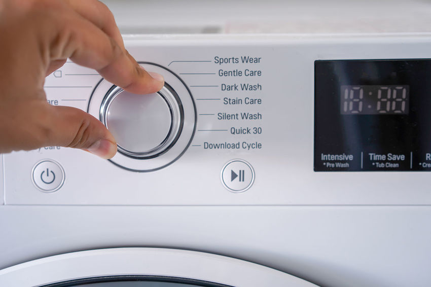 Human Hand Hand Human Body Part One Person Body Part Real People Indoors  Finger Human Finger Lifestyles Text Unrecognizable Person Western Script Washing Machine Technology Holding Close-up Household Equipment Leisure Activity Push Button