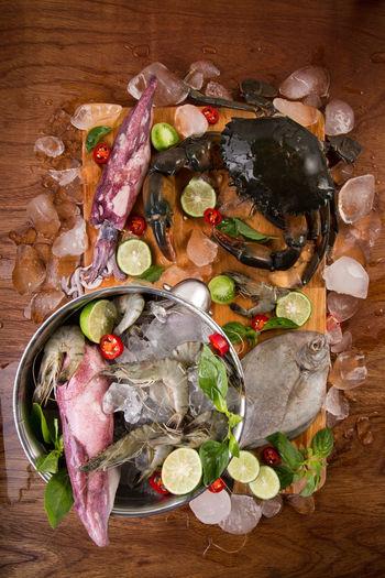 Fresh Sea Food Arrangement Art Calamari Chopping Board Close-up Cold Crab Cumi Dingin Fish Fresh Ice Blocks Ikan Kepiting Lime Multi Colored No People Prawns Ready-to-eat Seafood Segar Still Life Udang Variation