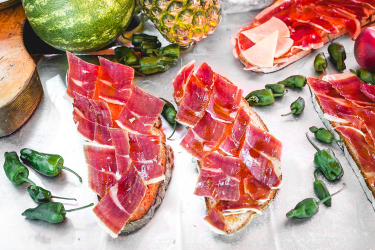 Delicious tasty street food at a market in Spain. Iberian ham toast with tomato Cooking Cuisine Food And Drink Ham Market Travel Vegetables & Fruits Bread Croquette Food Fresh Fruits Gourmet Grill Grilled Healthy Iberic Ham Meat Organic Food Restaurant Shop Street Street Food Traditional Vegetables