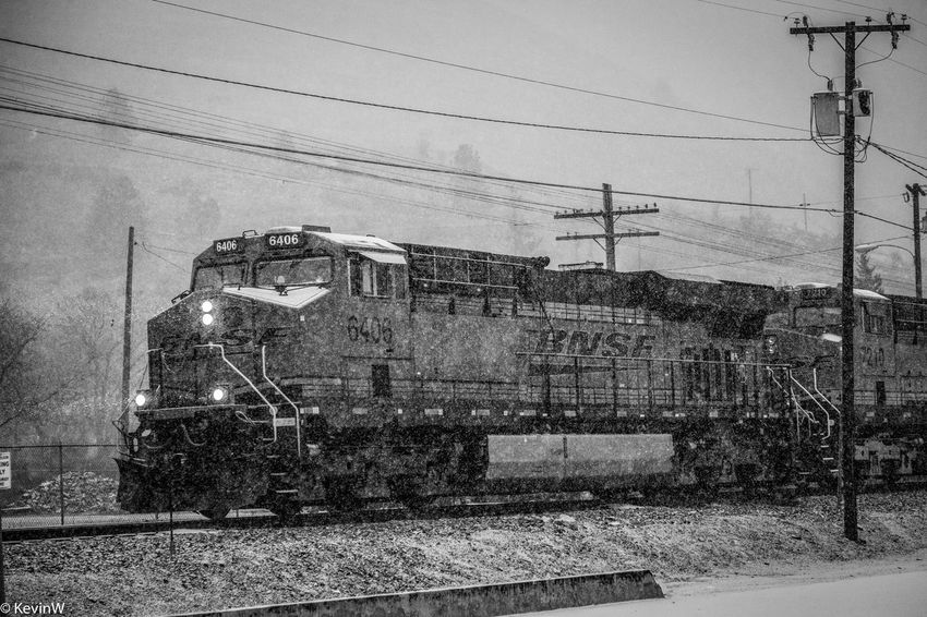 A train in Missoula, Montana during a heavy snowstorm. Cable Cold Temperature Connection Day Electricity  Electricity Pylon Locomotive Mode Of Transport No People Outdoors Power Line  Power Supply Public Transportation Rail Transportation Railroad Track Railway Signal Railway Track Sky Snow Steam Train Technology Train - Vehicle Transportation Winter