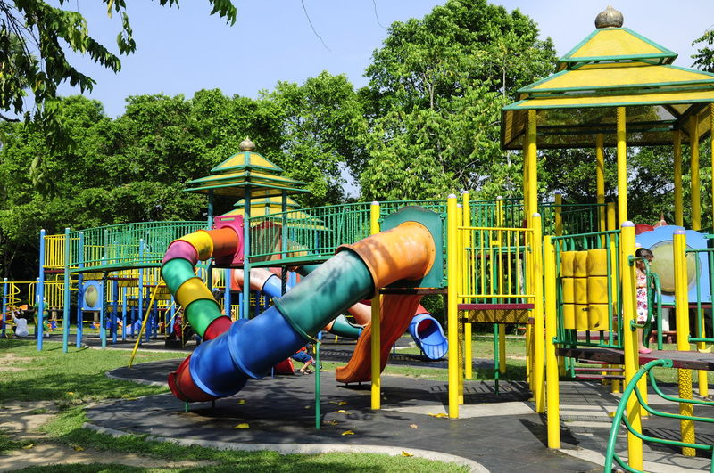 Girl standing on jungle gym at park