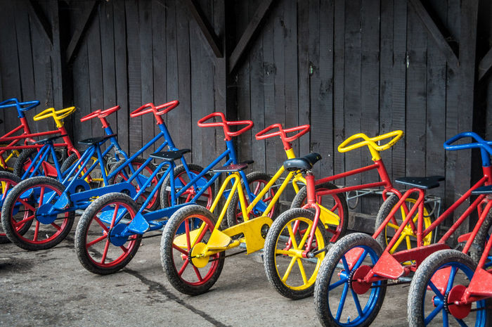 All In A Row Bicycle Built Structure Creativity Day Garage Many Of A Kind Multi Colored No People Outdoors Parking Wall Wall - Building Feature The Color Of School