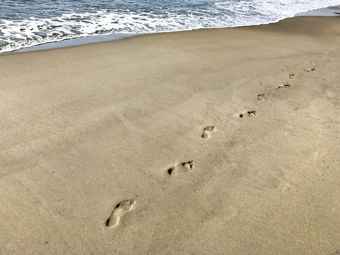Footprints in sand on beach Beach Beauty In Nature Close-up Day Foodprint FootPrint Nature No People Outdoors Sand Sea Water