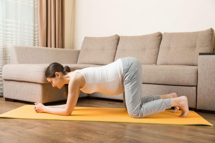 Full length of woman lying on sofa