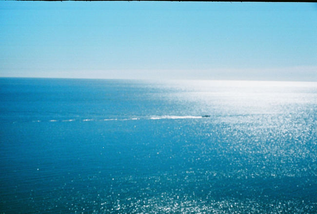 A fishing boat in the distance. A bright sunny day on Cape Cod, Massachusetts. Captured with a Leica ii on 35mm Fujifilm. Beauty In Nature Blue Calm Cape Cod Coastline Day Horizon Over Water Idyllic Massachusetts Nature New England  No People Ocean Outdoors Remote Rippled Scenics Sea Seascape Sky Summer Tranquil Scene Tranquility Water Waterfront