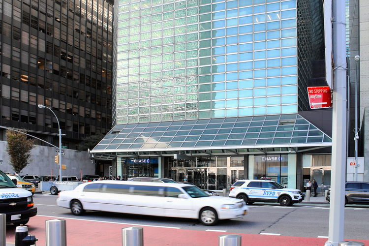 New York, USA - 26 September 2016: Police line the streets outside the One United Nations Plaza on First Avenue between East 44th and 45th streets, Manhattan. One United Nations Plaza 1st Avenue Limo New York New York City Politics Security Architecture Building Exterior Car City Day First Avenue Limousine Outdoors Police Protection Road Street Transportation World Politics