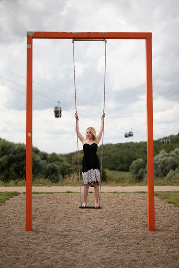 Full length of girl playing in playground