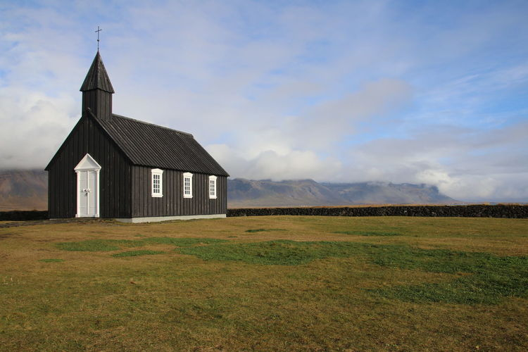 Wooden church close to the shores of Iceland EyeEm Best Shots EyeEm Selects Field Green Field Colored Field Church Wooden Church  Black Church Wooden Black Church Religion Spirituality Sky Rural Scene Field Agriculture No People Built Structure Architecture Outdoors Building Exterior
