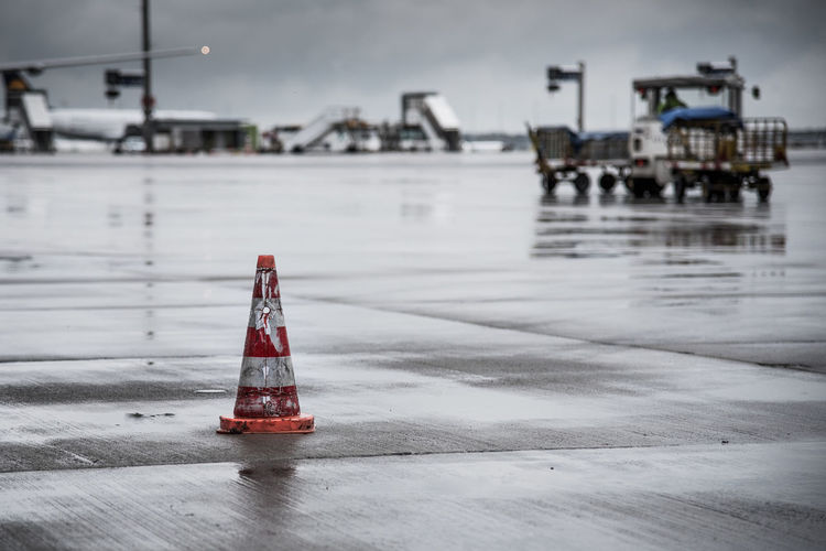Traffic cone on wet airport runway