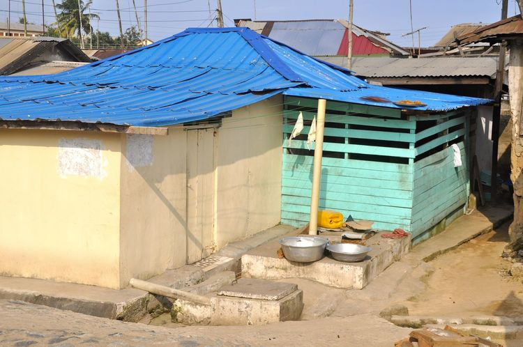 Accra Africa African Bad Condition Bowl Cook Outside Cooking Corrugated Metal Dweller Dwelling Ghana House Housing Hut Living Nissen Hut Poor  Poor People  Poverty Residential District Ribbed Roof Shanty Slum