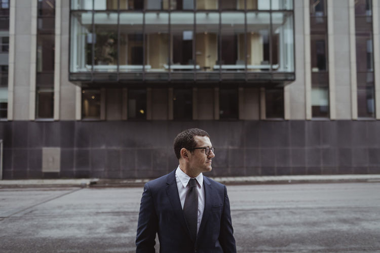 Man standing in front of office building