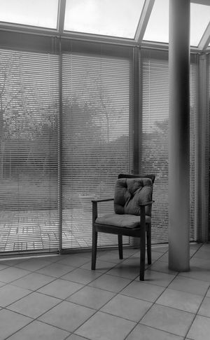 Le vide s'installe No People Full Length Indoors  One Person Sitting Seat Chair Architecture Depression - Sadness Window Day Lifestyles Built Structure