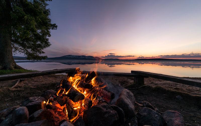 Bonfire by riverbank