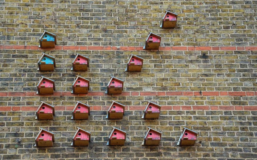 Birdhouse Formation Birdhouse Brick Wall Wall - Building Feature Architecture Built Structure Building Exterior No People Outdoors Day Façade Arrow Formation Arrow Decoration Bird Feeder Art Is Everywhere
