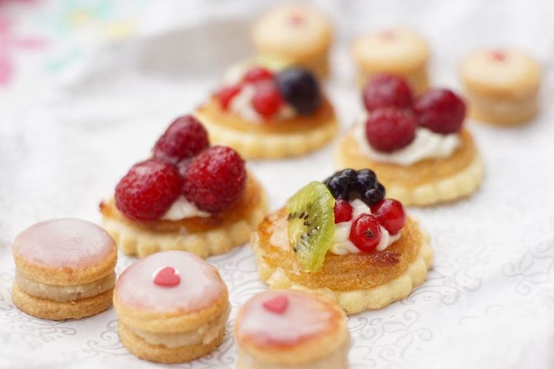 Close-up of cookies with jam and fresh fruits