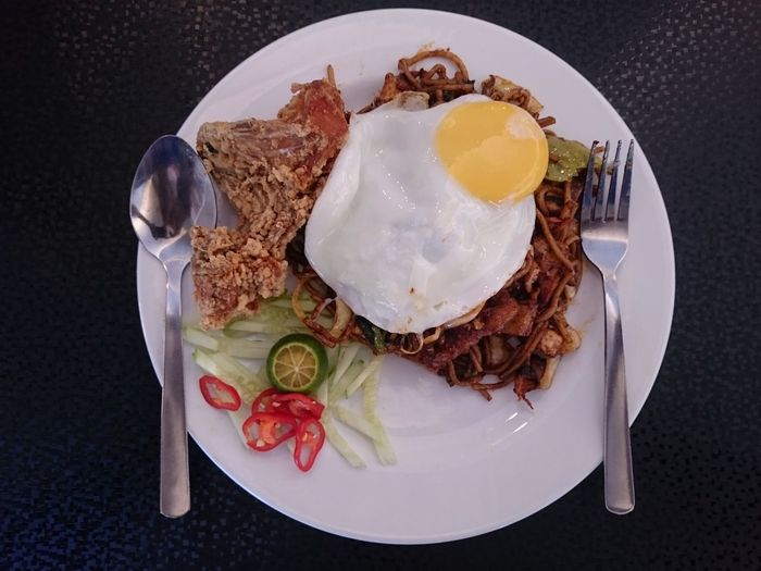 EyeEm Selects Plate Egg Breakfast High Angle View Fried Egg Egg Yolk Black Background Ready-to-eat Freshness Close-up Day Indoors  No People Mee Goreng Mamak Malaysian Food Fried Mee Fork Food Malaysia Truly Asia EyeEmNewHere