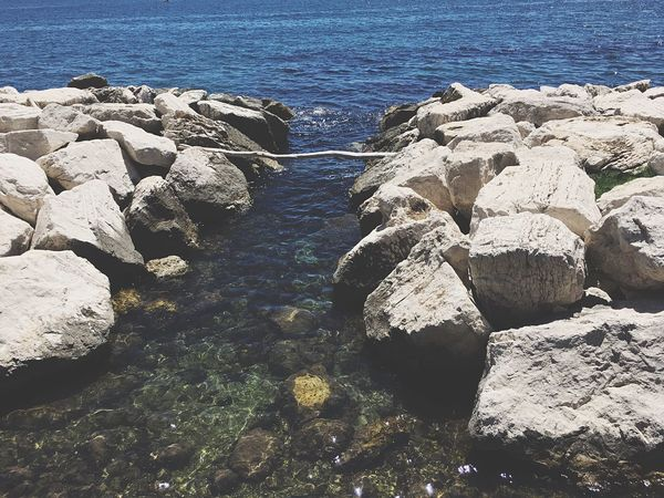 Water Sea Rock - Object Nature Beauty In Nature Rock Formation Outdoors Tranquility No People Day High Angle View Scenics Beach Sunlight Horizon Over Water Pebble Beach