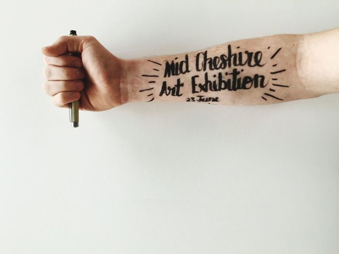 Cropped image of hand with text against white background