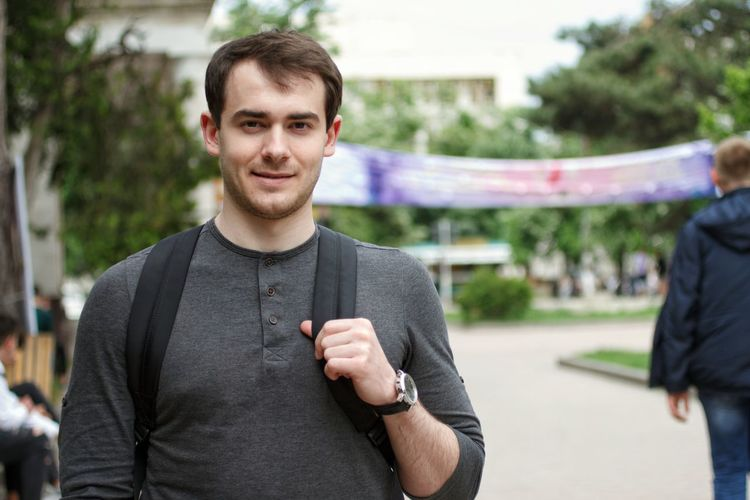 Portrait of young man standing outdoors