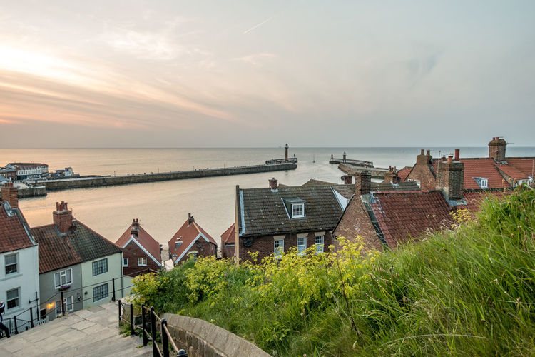 Whitby Whitby Harbour Whitby View Whitby North Yorkshire North Yorkshire North Yorkshire Coast Seaside Seaside Town Coastal Sky Architecture Water Cloud - Sky Horizon Over Water Beauty In Nature Outdoors No People House Sea Roof Building Horizon Built Structure Sunset Building Exterior