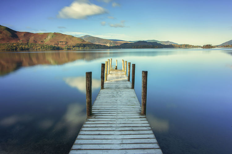 Jetty on Still Waters Water Scenics - Nature Sky Mountain Tranquil Scene Tranquility Beauty In Nature Direction Lake Wood - Material Nature Pier Day Reflection No People Idyllic Jetty Blue Outdoors Post Diminishing Perspective Long Landscape_photography Lakedistrict Nikonphotography