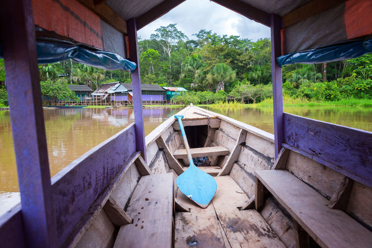 Purple canoe arriving at an island in the Amazon River near Iquitos, Peru Amazon Amazon River Amazonas Amazonia Boat Canoe Day Forest Green Color Iquitos  Jungle Nature No People Outdoors Paddle Peru Purple Rain Forest Rainforest River Sky South America Tree Water Wood - Material