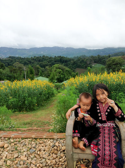 Hill tribe Bonding Casual Clothing Child Childhood Cute Family Females Growth High Angle View Landscape Leisure Activity Mountain Nature Outdoors Plant Positive Emotion Real People Sitting Togetherness Tree Two People